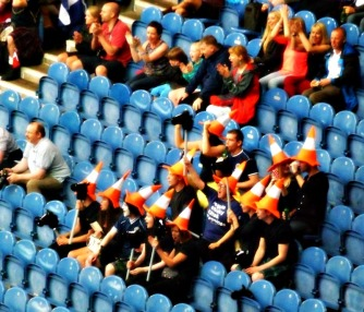 Fans wearing traffic cone hats at the Glasgow 2014 rugby sevens